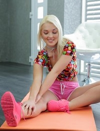 Platinum blonde wearing tight pink shorts loves yoga because this lifts her spirits up and makes the hot body look even hotter. Her sparkling beauty and cheerful mood inspire the hottie to show off the awesome body right in the middle of a yoga session. The blonde slowly undresses and stretches completely naked on a mat. She teasingly opens her thighs and demonstrates wet hole that craves deep penetration. Lustful babe drives herself insane until screaming from a powerful climax.